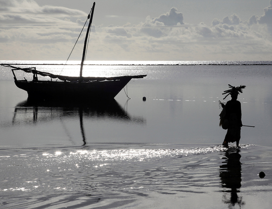 A woman carried wood in Matwemwe, Zanzibar.