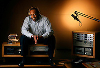 Tony Benton, shown in his Clearchannel production studio in Seattle Wednesday, Dec. 3, 2008, is many things to many people - an executive at Clearchannel radio, former hip-hop producer and sometime sports commentator. But on Sundays his truest self comes out, as host of the radio talk show StreetBeat.(Photo by Andy Rogers)