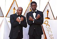 John Singleton, left, and Damson Idris arrive at the Oscars on Sunday, March 4, 2018, at the Dolby Theatre in Los Angeles. (Photo by Jordan Strauss/Invision/AP)