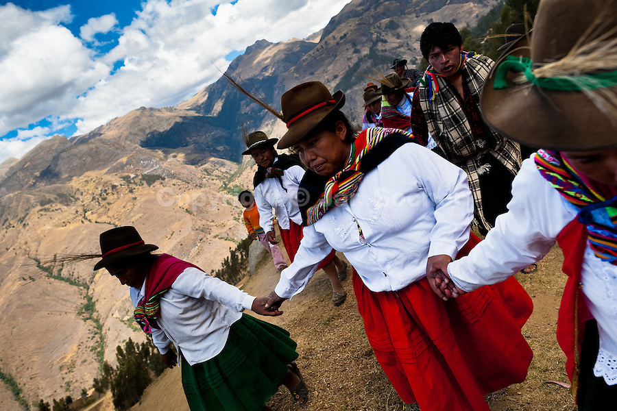 Peruvian indigenous women dance before the Yawar Fiesta, a ritual fight between the condor and the bull, held in the mountains of Apurímac, Cotabambas, Peru, 28 July 2012. The Yawar Fiesta (Feast of Blood), an indigenous tradition which dates back to the time of the conquest, consists basically of an extraordinary bullfight in which three protagonists take part - a wild condor, a wild bull and brave young men of the neighboring communities. The captured condor, a sacred bird venerated by the Indians, is tied in the back of the bull which is carefully selected for its strength and pugnacity. A condor symbolizes the native inhabitants of the Andes, while a bull symbolically represents the Spanish invaders. Young boys, chasing the fighting animals, wish to show their courage in front of the community. However, the Indians usually do not allow the animals to fight for a long time because death or harm of the condor is interpreted as a sign of misfortune to the community.