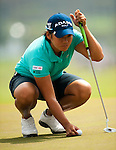 Yani Tseng of Taiwan lines up a putt on the the 1st green during day one of the Sunrise LPGA Taiwan Championship 2011 at the Sunrise Golf & Country Club on 20 October 2011 in Tao Yuan, Taiwan. Photo by Victor Fraile / The Power of Sport Images