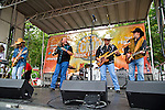 Stuart Swanlund, Doug Gray, Pat Elwood, and Rick Willis of The Marshall Tucker Band perform during Day 1 of the 2013 CMA Music Festival in Nashville, Tennessee.