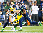 Seattle Seahawks wide receiver Percy Harvin runs for 33-yards and past Green Bay Packers linebacker Clay Matthews (52) during the fourth quarter of the NFL Kickoff held at CenturyLink Field September 4, 2014 in Seattle. Harvin returned three kickoffs for 60 yards, also caught seven passes for 59 yards and rushed for 41.   Seattle beat Green Bay 36-16. ©2014  Jim Bryant Photo. ALL RIGHTS RESERVED.