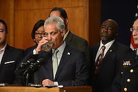 Chicago Mayor Rahm Emanuel takes a sip of water during a press conference at Chicago City Hall announcing more Tasers for Chicago police officers and training following a deadly shooting involving Chicago police over the weekend while Mayor Emanuel was on vacation in Cuba in Chicago, Illinois on December 30, 2015.  Over the weekend, Chicago police shot and killed 55 year old Bettie Jones and 19 year old Quintonio LeGrier while responding to a call over a domestic incident.