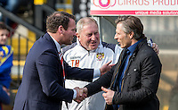 Darren Sarll of Stevenage shake hands with Wycombe Wanderers Manager Gareth Ainsworth as Stevenage Assistant Manager Terry Harris (centre) looks on during the Sky Bet League 2 match between Wycombe Wanderers and Stevenage at Adams Park, High Wycombe, England on 12 March 2016. Photo by Andy Rowland/PRiME Media Images.
