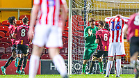 Goalkeeper Jack Barrett of Bradford City celebrates with <br /> Teammate Finn Cousin-Dawson (6) after saving a penalty from Adam Porter (16) of Stoke City during the FA Youth Cup match between Bradford City U18 and Stoke City U18 at the Northern Commercial Stadium, Bradford, England on 12 December 2019. Photo by Thomas Gadd.