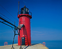 Van Buren County, MI   <br /> South Haven South Pier Lighthouse and catwalk in morning sun on the shores of Lake Michigan