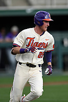 Third baseman Patrick Cromwell (25) of the Clemson Tigers runs out a batted ball in a game against the Furman Paladins on Tuesday, February 20, 2018, at Doug Kingsmore Stadium in Clemson, South Carolina. Clemson won, 12-4. (Tom Priddy/Four Seam Images)