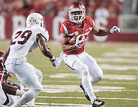 STAFF PHOTO ANTHONY REYES • @NWATONYR<br /> Arkansas receiver Jared Cornelius looks for a gap against Northern Illinois University in the fourth quarter Saturday, Sept. 20, 2014 at Razorback Stadium in Fayetteville. The Razorbacks won 52-14.