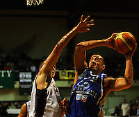 Brendon Polybank tries to shoot under pressure from Phill Jones during the NBL Semifinal basketball match between the Wellington Saints and Nelson Giants at TSB Bank Arena, Wellington, New Zealand on Thursday, 12 June 2008. Photo: Dave Lintott / lintottphoto.co.nz