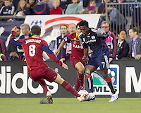 New England Revolution midfielder Kenny Mansally (7) dribbles in a crowd, Real Salt Lake midfielder Will Johnson (8) and Real Salt Lake defender Tony Beltran (2). Real Salt Lake defeated the New England Revolution, 2-1, at Gillette Stadium on October 2, 2010.