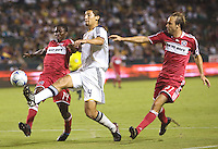 LA Galaxy rookie defender Omar Gonzalez beats Chicago Fire players Patrick Nyarko (14) and Justin Mapp (21) to the ball. The LA Galaxy defeated the Chicago Fire 1-0 at Home Depot Center stadium in Carson, California on Friday October 2, 2009...