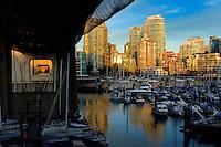 Vancouver area of Burrard bridge showing apartment, office blocks marina and Burrard bridge at dusk. bridge British Columbia, Canada