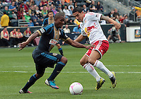 CHESTER, PA - OCTOBER 27, 2012:  Michael Lahoud (13) of the Philadelphia Union with  Tim Cahill (17) of the New York Red Bulls during an MLS match at PPL Park in Chester, PA. on October 27. Red Bulls won 3-0.