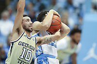 CHAPEL HILL, NC - JANUARY 4: Jose Alvarado #10 of Georgia Tech gets tangled up while fighting for the ball during a game between Georgia Tech and North Carolina at Dean E. Smith Center on January 4, 2020 in Chapel Hill, North Carolina.