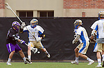 Los Angeles, CA 02/15/14 - Bryan Kift (UCLA #7) and Nathan Puldy (Washington #27) in action during the Washington versus UCLA  game as part of the 2014 Pac-12 Shootout at UCLA.  UCLA defeated Washington 13-7.