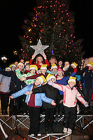 "NO REPRO FEE. 17/12/2010. Focus Ireland festive lights. Pamela Flood , Joyce Loughnan, CEO Focus Ireland and children from the Piccolo Lasso Choir switched on the lights on the Christmas Tree at Grafton St. this evening (Fri Dec 17th) for the Focus Ireland ""Sponsor a Star"" campaign. EUR250,000 has been raised by businesses sponsoring a star on the landmark tree which is dedicated to people who are homeless. Picture James Horan/Collins Photos"