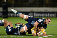 Nehe Milner-Skudder ( Hurricanes ) and Luke Braid ( Blues ) in action during the Super Rugby - Hurricanes v Blues at FMG Stadium, Palmerston North, New Zealand on Friday 13 March 2015. <br /> Photo by Masanori Udagawa. <br /> www.photowellington.photoshelter.com.