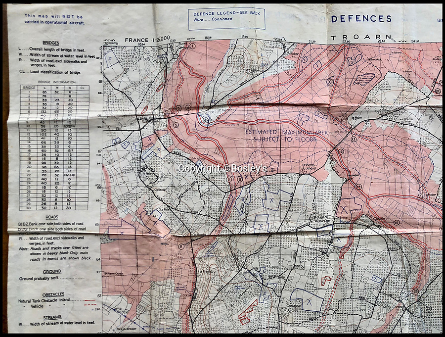 BNPS.co.uk (01202 558833)<br /> Pic :   Bosley's/BNPS<br /> <br /> The maps of Normandy showing the drop zones.<br /> <br /> Top secret maps and documents belonging to a hero medic who served on D-Day have been unearthed 75 years later.<br /> <br /> Douglas Protheroe helped set up a field hospital at the cafe next to Pegasus Bridge in Normandy in the aftermath of the famous British assault there just after midnight on June 6, 1944.<br /> <br /> The team of medics removed wounded men from the bridge over the Caen Canal, coming under enemy fire while doing so.<br /> <br /> The maps showing Protheroe's drop zone are being sold by Bosley's Auctioneers.