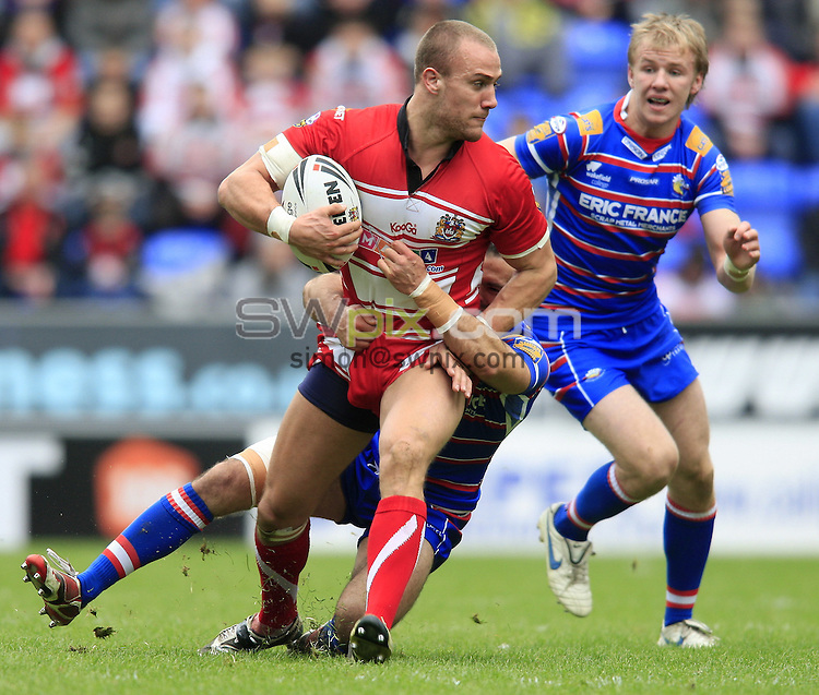 Pix: Chris Mangnall /SWPix.com, Rugby League, Super League. 05/04/10 Wigan Warriors v Wakefield Trinity Wildcats....picture copyright>>Simon Wilkinson>>07811267 706>>....Wigan's Lee Mossop tackled by Wakefield's Ben Jeffries