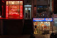 Chinese restaurant and Lucky Crystal Readings at night, in Chinatown, Manhattan, New York, New York, USA. This is the largest enclave of Chinese people in the Western Hemisphere and one of 9 Chinatown districts in New York City. Picture by Manuel Cohen