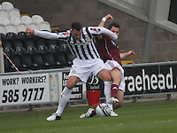 Steven Thompson tackled by Ryan McGowan in the St Mirren v Heart of Midlothian Clydesdale Bank Scottish Premier League match played at St Mirren Park, Paisley on 15.9.12.