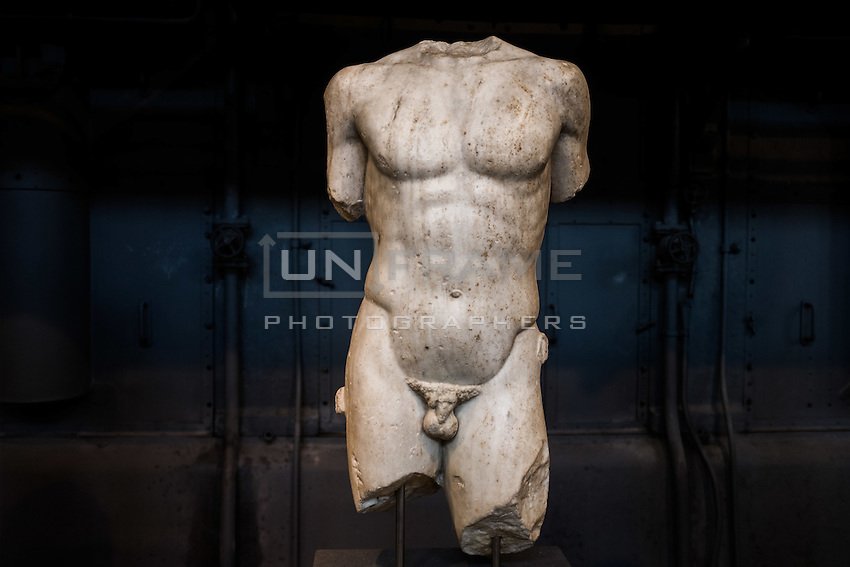Statue of Apollo, sculpture copy after Greek model exhibited in the Hall of the Machines. Centrale Montemartini. Rome, Italy. Mar. 07, 2015