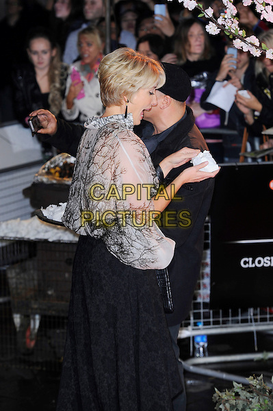 Emma Thompson <br /> attending the 57th BFI London Film Festival Closing Night Gala World Premiere of 'Saving Mr Banks', Odeon Cinema, Leicester Square, London, England. <br /> 20th October 2013<br /> half length black skirt beige white pattern blouse top profile side mouth open funny  <br /> CAP/MAR<br /> &copy; Martin Harris/Capital Pictures