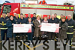 FUNDS: Receiving cheques from the Tralee fire station staff as a result of their Christmas fundraiser were l-r: Helen O'Sullivan and Mary Bonn of Kerry General Hospital, Anne McCarthy, Maria Heaslip and Kay McNamara of the Rosemary Centre for Alzheimers sufferers.