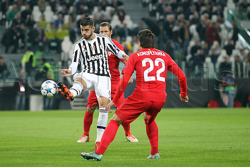 30.09.2015. Turin, Italy. Champions League. Juventus versus Sevilla. Alvaro Morata is challenged by Evgen Konoplyanka