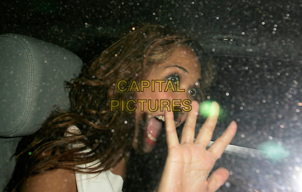 MYLEENE KLASS.British Comedy Awards 2006, London Television Studios, London, UK. - Departures.December 13th, 2006.headshot portrait car funny face hand mouth open.CAP/AH.©Adam Houghton/Capital Pictures