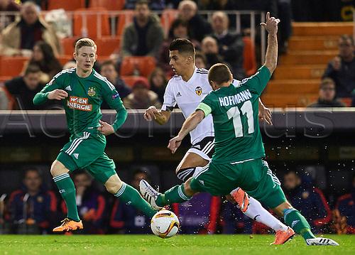 18.02.2016. Mestalla Stadium, Valencia, Spain. Europa League. Valencia versus Rapid Wien. Defender Joao Cancelo of Valencia CF (C) is challenged by Hoffman of Rapid