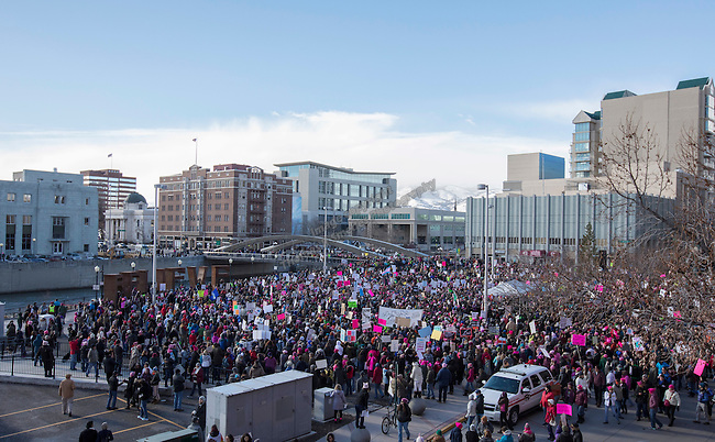 Activists gather at the City Plaza after the Reno Women's March on Washington event on Virginia Street in downtown Reno on Saturday, Jan. 21, 2017.