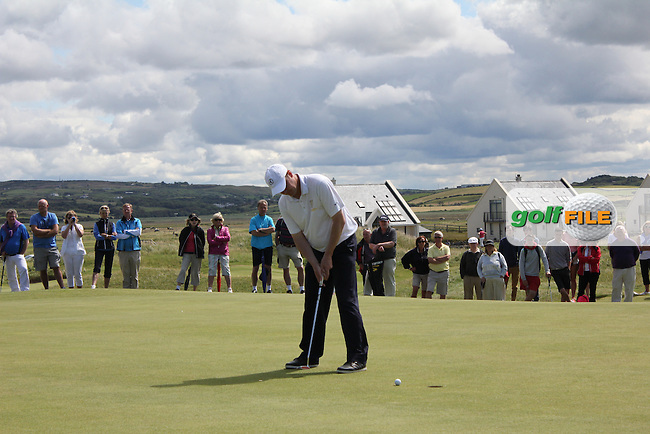 Niall Gorey (Palmerstown Stud) on the 15th green during Matchplay Round 3 of the South of Ireland Amateur Open Championship at LaHinch Golf Club on Saturday 25th July 2015.<br /> Picture:  Golffile | TJ Caffrey