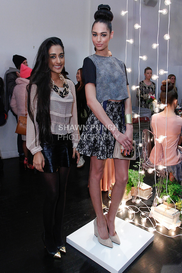 Fashion designer Misha Vaidya poses next to models at her By Misha Autumn Winter 2014 Eloquence collection fashion presentation, during New York Fashion Week Fall 2014, February 10, 2014.