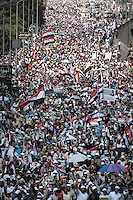 In this Friday, Jul. 19, 2013 photo, Muslim supporters of the ousted president Mohammed Morsi demonstrate during a massive rally in the streets nearby Al Rabaa mosque in Nasr City, Cairo. (Photo/Narciso Contreras).