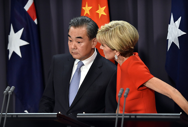 Australian Foreign Minister Julie Bishop (R) speaks to Chinese Foreign Minister Wang Yi (L) during a press conference at Parliament House Canberra, Tuesday Feb 7, 2017. AFP PHOTO/ MARK GRAHAM