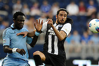 Kei Kamara Sporting KC and Newcastle defender Jonas Gutierrez keep their eyes on the ball... Sporting Kansas City and Newcastle United played to a scoreless tie in an international friendly at LIVESTRONG Sporting Park, Kansas City, Kansas.