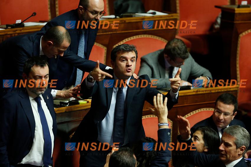 Senators arguing at Senate. Gian Marco Centinaio makes gestures to another senator<br /> Rome December 12th 2019. Speech of the Italian Premier about MES, European Stability Mechanism.<br /> Foto Samantha Zucchi Insidefoto