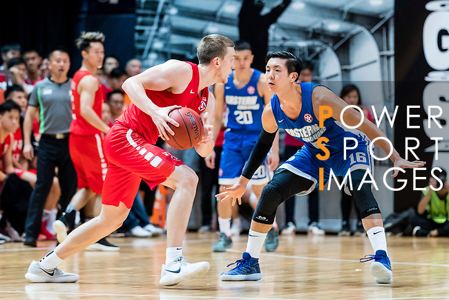 Dominic Robert Gilbert #11 of SCAA Men's Basketball Team goes to the basket against the Xu Adam #16 of Eastern Long Lions during the Hong Kong Basketball League playoff game between SCAA and Eastern Long Lions at Queen Elizabeth Stadium on July 27, 2018 in Hong Kong. Photo by Yu Chun Christopher Wong / Power Sport Images