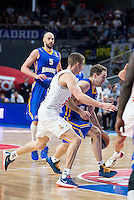 Real Madrid's Jaycee Carroll and Khimki Moscow's Petteri Koponen and James Augustine during Euroleague match at Barclaycard Center in Madrid. April 07, 2016. (ALTERPHOTOS/Borja B.Hojas) /NortePhoto