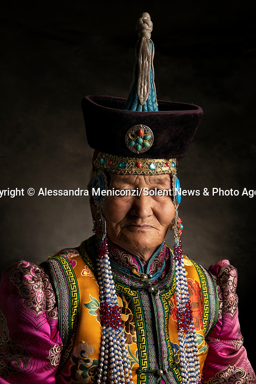 "Pictured: The spectacular traditional clothes of Mongolian Nomads are showcased in a series of beguiling portrait shots.   These brightly coloured and bejewelled garments are handed down through generations.<br /> <br /> Freelance photographer Alessandra Meniconzi travelled from her home in Lugano, Switzerland, to Central Mongolia to set up the shoot.   Ms Meniconzi said: ""In the past the kings and queens and royalty of the Mongolian nomads used to wear these traditional clothes which are decorated with the beautiful jewels.  SEE OUR COPY FOR DETAILS<br /> <br /> Please byline: Alessandra Meniconzi/Solent News<br /> <br /> © Alessandra Meniconzi/Solent News & Photo Agency<br /> UK +44 (0) 2380 458800"