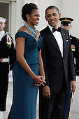 First lady Michelle Obama and U.S. President Barack Obama await the arrival of British Prime Minister David Cameron and his wife Samantha on the North Portico of the White House March 14, 2012 in Washington, DC. Cameron is on a three-day visit to the U.S. and he was expected to have talks with Obama on the situations in Afghanistan, Syria and Iran..Credit: Chip Somodevilla / Pool via CNP