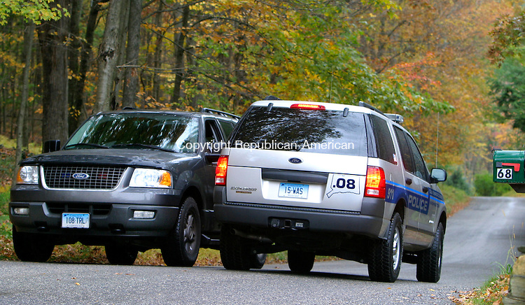 WASHINGTON, CT. 17 October 2006--101706SV03--DEP and  Washington police patrol the road where a jogger was attacked by a coyote on Lower Church Hill Road in Washington early Tuesday.<br /> Steven Valenti Republican-American