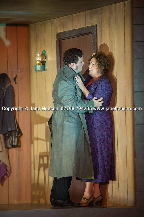 "London, UK. 30.09.2014. English National Opera's production of ""The Girl of the Golden West"", by Giacomo Puccini, directed by Richard Jones, conducted by Keri-Lynn Wilson, opens at London Coliseum. Picture shows: Peter Auty (Dick Johnson) and Susan Bullock (Minnie). Photograph © Jane Hobson."