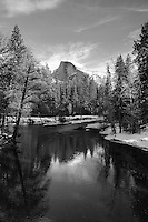 Winter reflections of Half Dome and surrounding treeline in the Merced River