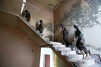 Members of AMISOM and the Somali National Army search the building.