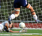 Tolland goalie Jessica Olsen, tries to stop the ball driven into the goal by Fermi 30, Rachel VanGilder, who jumps to avoid a collision, in the beginning of the 2nd half of play, Wednesday, Sept. 22, 2010, at Fermi High School. The goal held up, Fermi won the game 1-0.