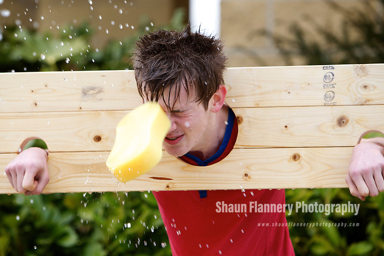 Pix: Shaun Flannery/shaunflanneryphotography.com...COPYRIGHT PICTURE>>SHAUN FLANNERY>01302-570814>>07778315553>>..19th March 2011...............Lakeside Village, Doncaster..Comic Relief Event..In the Stocks, Ashton Harrison gets a soaking.