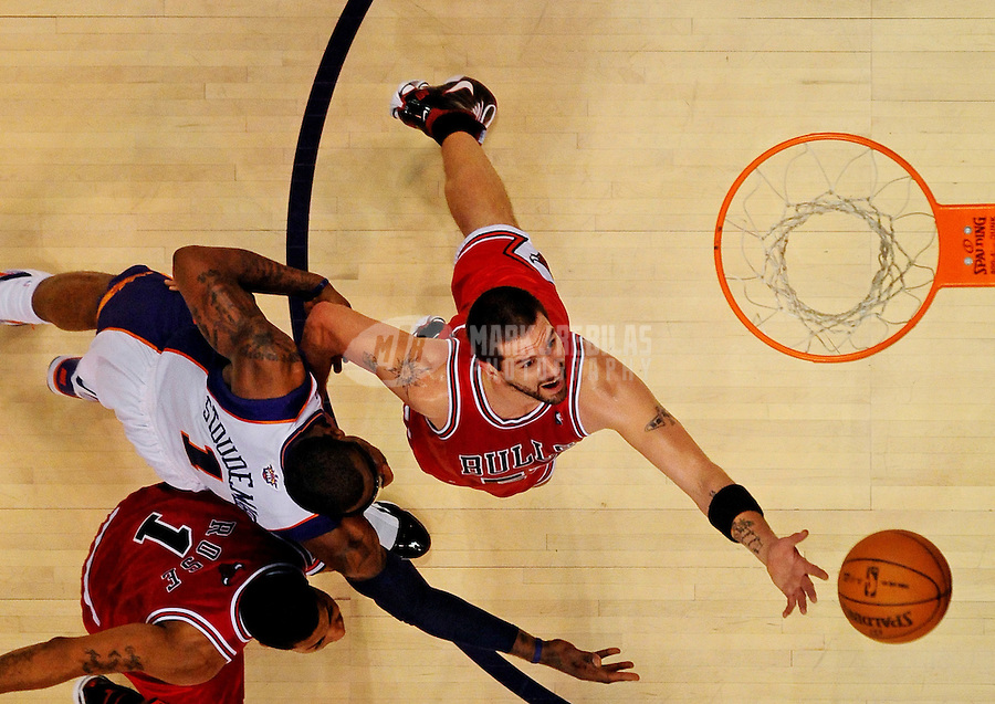 Jan. 22, 2010; Phoenix, AZ, USA; Chicago Bulls center Brad Miller reaches for a rebound in the second half against the Phoenix Suns at the US Airways Center. Chicago defeated Phoenix 115-104. Mandatory Credit: Mark J. Rebilas-